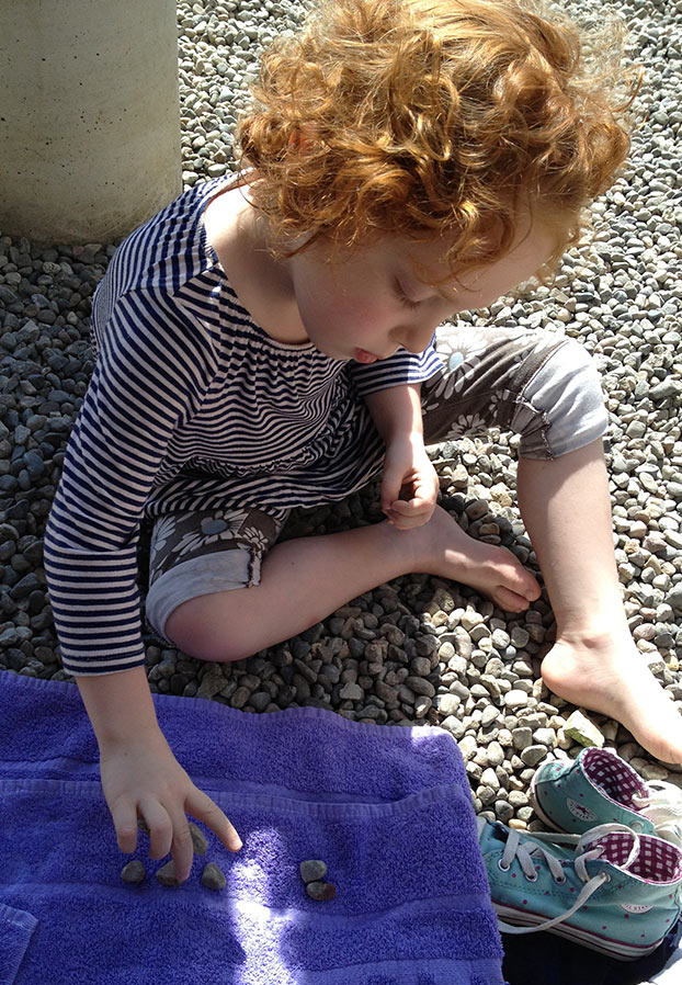 While brothers were off looking for starfish, Leah decided to search the rocks for one shaped like a heart.